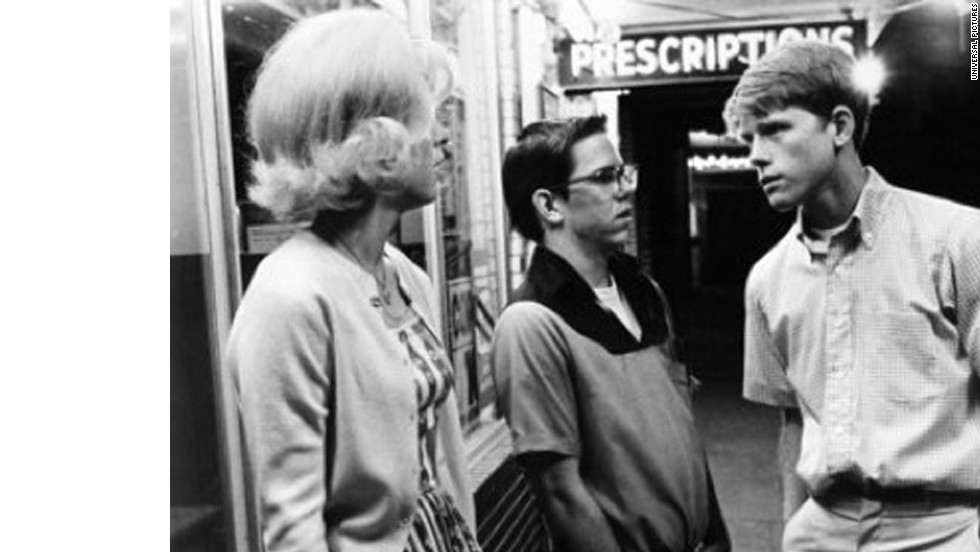 "<strong>""American Graffiti"" (1973)</strong>: Candy Clark, from left, Charles Martin Smith and Ron Howard appear in the nostalgic classic that focuses on a group of high school graduates who come together for one last night of cruising before they head off to college."