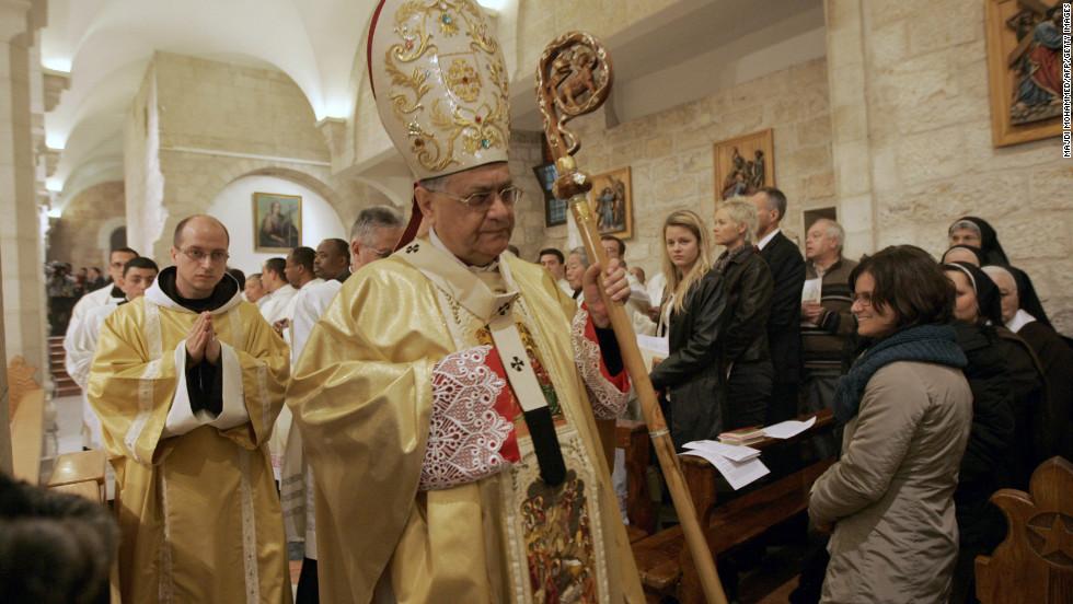 Latin Patriarch of Jerusalem Fouad Twal leading last year's Christmas midnight Mass at the church.