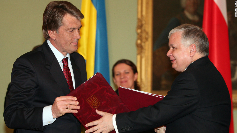 Instead the joint bid from Ukraine and Poland, which had been third favorite out of three candidates, was awarded the event. Here former Ukrainian President Victor Yushchenko (R) exchanges a signed trade agreement with his Polish counterpart Lech Kaczynski in Warsaw.