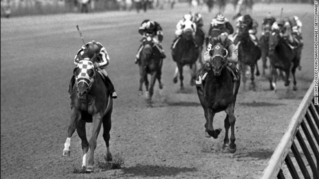 Secretariat, left, races toward a record win in the Kentucky Derby on May 5, 1973, at Churchill Downs in Louisville, Kentucky.