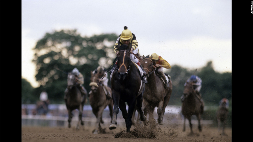 Jockey Jean Cruguet guides Seattle Slew to the Triple Crown in 1977.