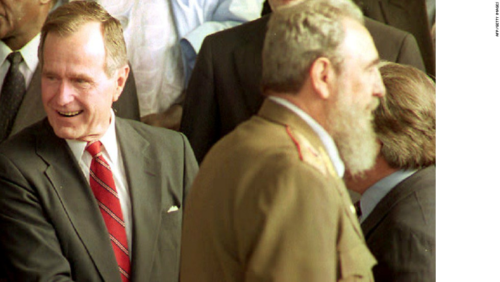 U.S. President George Bush looks aside as Cuban leader Fidel Castro passes in front of him at the 1992 summit. The two leaders did not greet each other.