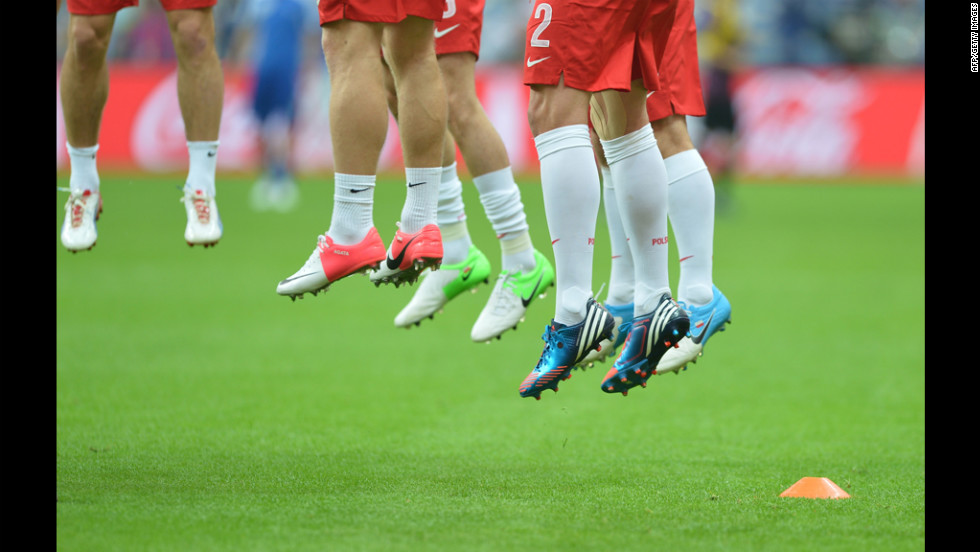 Players warm up before the match between Poland and Greece.