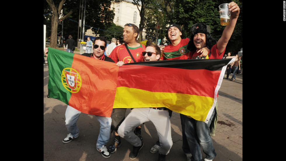 German and Portugese fans show off their nations' flags.