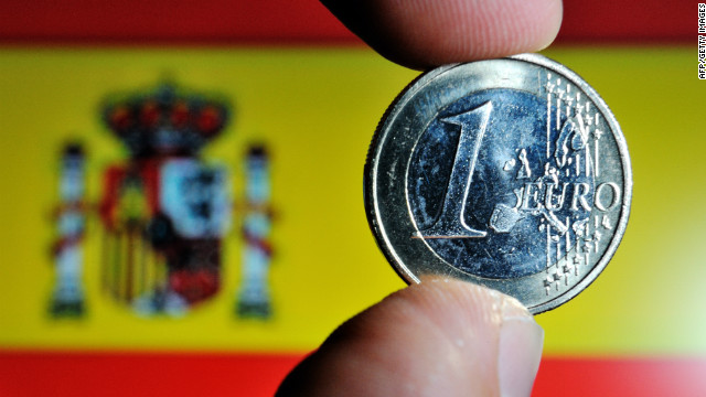 A file photo of the euro coin and the Spanish flag.