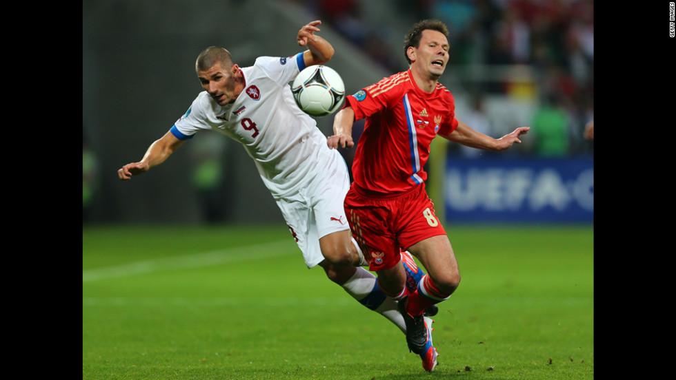 Konstantin Zyryanov of Russia and Jan Rezek of Czech Republic collide.