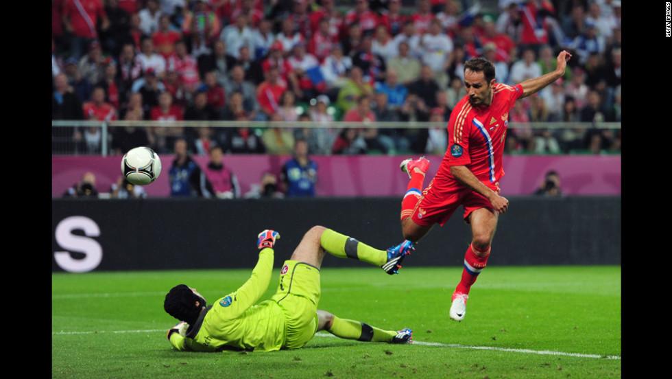 Roman Shirokov of Russia scores the team's second goal past Petr Cech of Czech Republic.