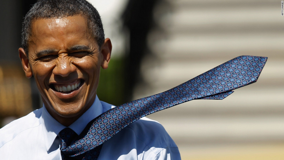 The wind sweeps Obama's tie over his shoulder as he makes his way back to the Oval Office after welcoming the Giants to the White House.  The Giants defeated the New England Patriots 21-17 to win Super Bowl XXXXVI.