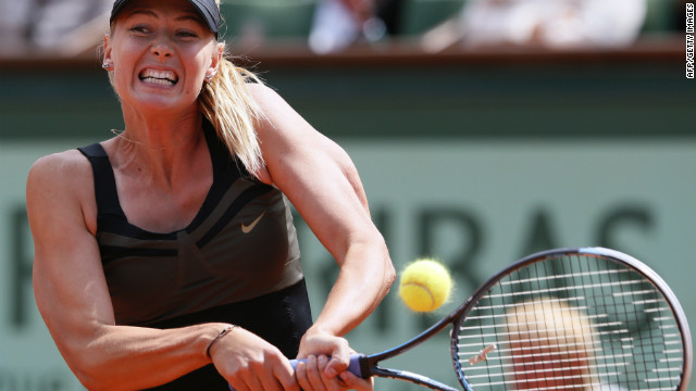 Russia's Maria Sharapova hits a return to Italy's Sara Errani during their Women's Singles final tennis match of the French Open tennis tournament at the Roland Garros stadium, on June 9, 2012 in Paris.