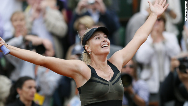 Russia's Maria Sharapova celebrates after winning against Italy's Sara Errani their Women's Singles final tennis match of the French Open