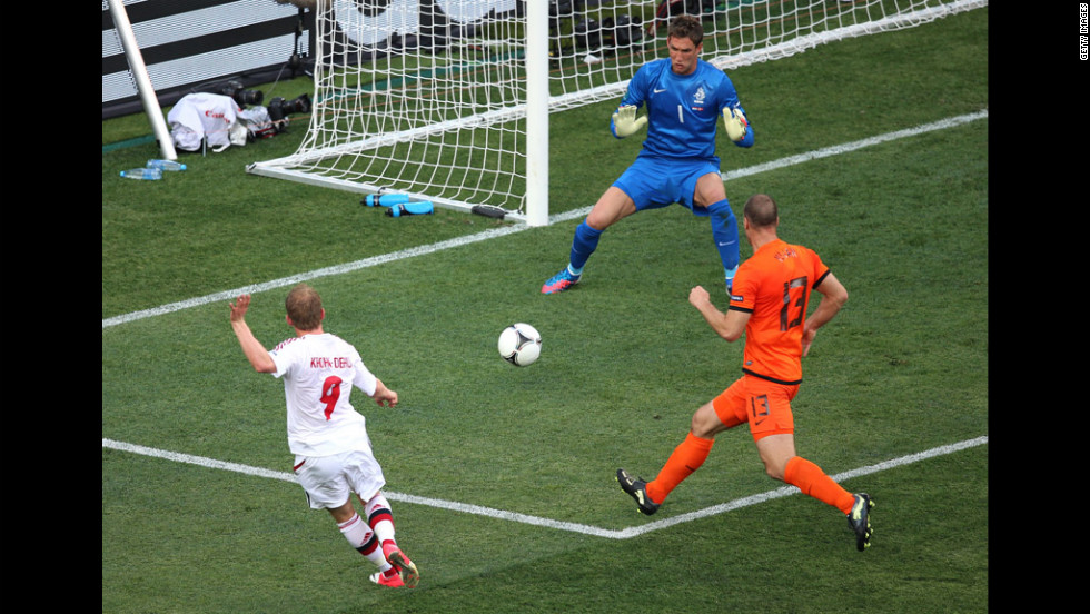 Michael Krohn-Dehli of Denmark scores the team's first goal past Maarten Stekelenburg of the Netherlands during a Group B match Saturday.