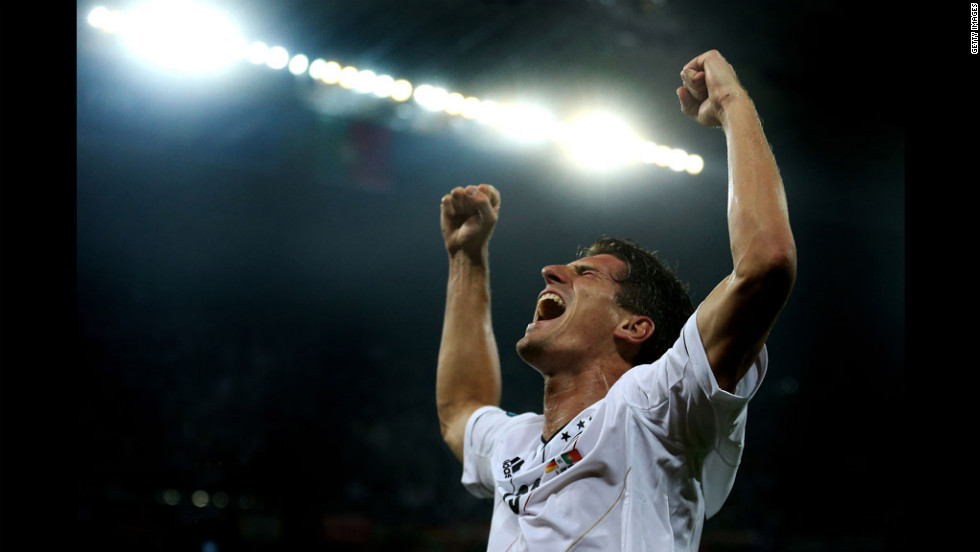 Mario Gomez celebrates Germany's first goal during the match against Portugal.