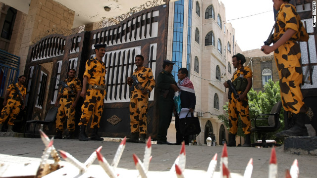 Yemeni troops guard a government building in the capital, Sanaa, last month following reported Al-Qaeda threats.