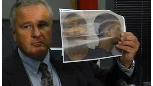 Auburn Police Chief Tommy Dawson at a news conference Sunday holds up a picture of Desmonte Leonard.
