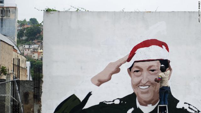 A mural of Venezuelan President Hugo Chavez goes up last week in Caracas. Chavez has led Venezuela since 1999.
