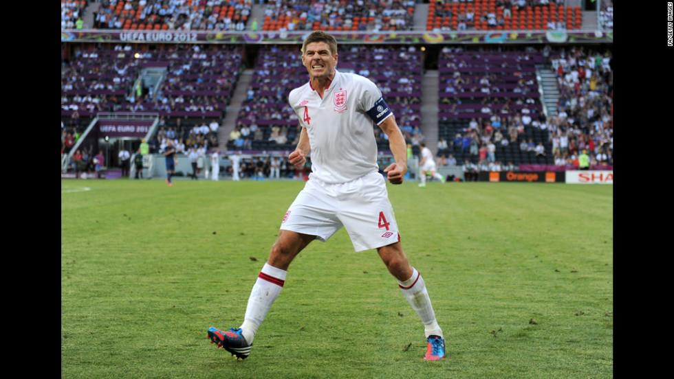 Steven Gerrard of England celebrates after Joleon Lescott's goal against France.