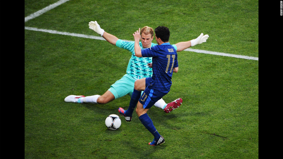 Goalkeeper Joe Hart of England blocks Samir Nasri of France during the Group D match in Donetsk, Ukraine, Monday, June11.