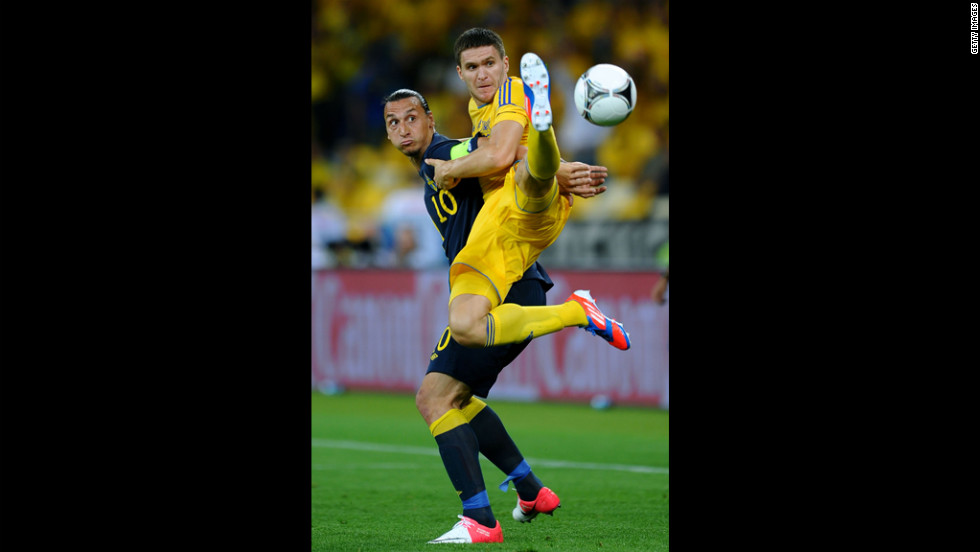 Yevhen Selin of Ukraine and Zlatan Ibrahimovic of Sweden battle for the ball.