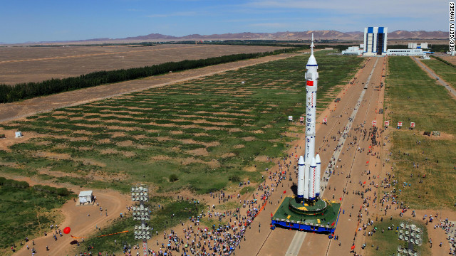 The Shenzhou-9 spacecraft and its carrier rocket as seen Saturday in northwest China's Gansu province.