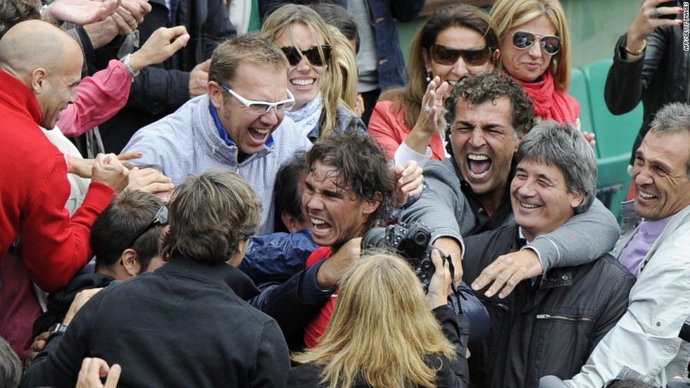 Rafael Nadal celebrates with his family and coaching staff after entering the history books at the French Open.