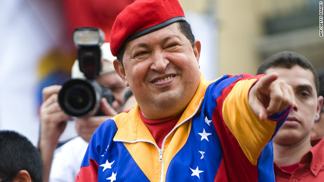 Venezuelan President Hugo Chavez (C) waves to supporters during a caravan before registering his candidacy in the National Electoral Center for the upcoming presidential election, in Caracas on June 11, 2012. Thousands of followers took to the streets of Caracas supporting his candidacy.