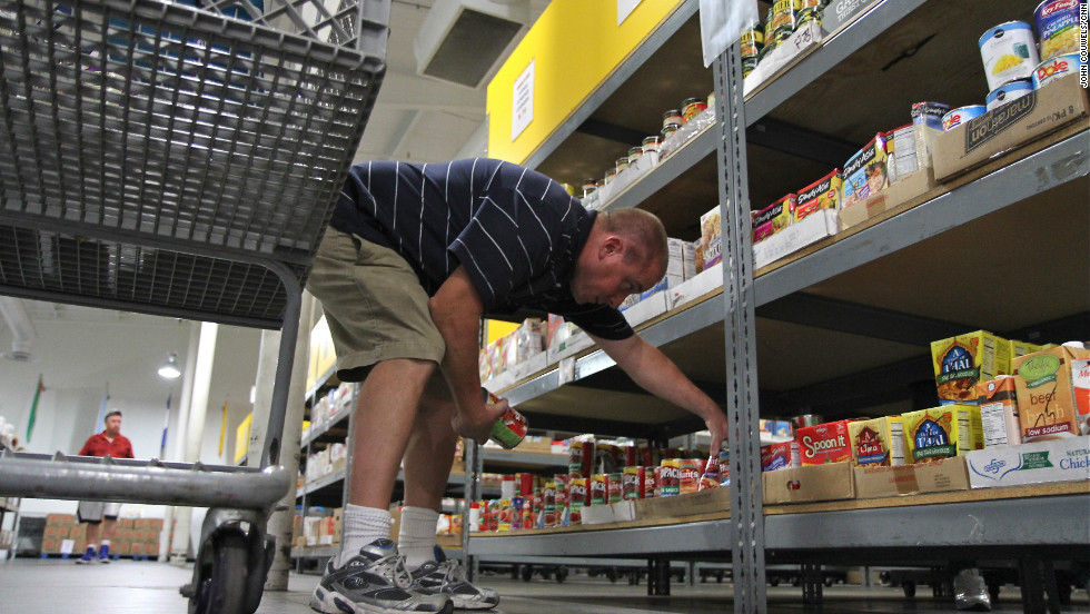 "Watson shops for food at the same food pantry, which is operated by a faith-based organization. ""I always find a way to find just enough,"" Watson says of buying food for him and his son. ""It's amazing!"""
