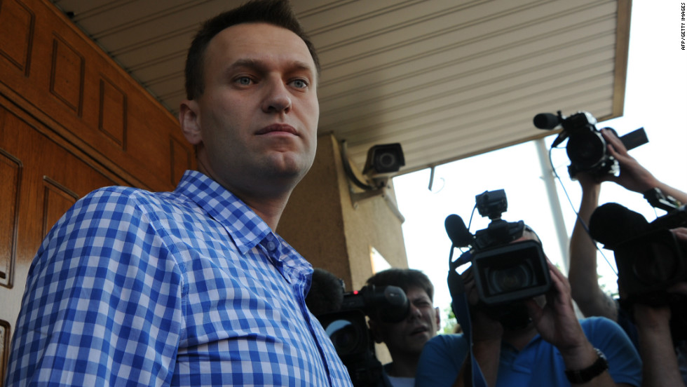Russian anti-corruption blogger Alexei Navalny stands at the entrance to a Federal Investigative Commision office in Moscow. He was arriving for questioning as part of a probe into last month's demonstration with bloody battles between riot police and a mostly young crowd.
