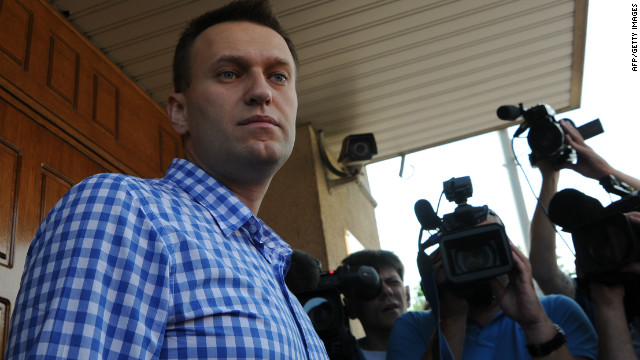 Russian anti-corruption blogger Alexei Navalny stands a the entrance to a Federal Investigative Commision office in Moscow, on June 12, 2012, as he arrives for questioning, a part of a probe into last month's demonstration with bloody battles between riot police and the mostly young crowd. Russian President Vladimir Putin's foes vowed today to defy a wave of police raids and the threat of fines the size of their annual salaries to join a monthly march against his 12-year rule. AFP PHOTO / ANDREY SMIRNOV (Photo credit should read ANDREY SMIRNOV/AFP/GettyImages)