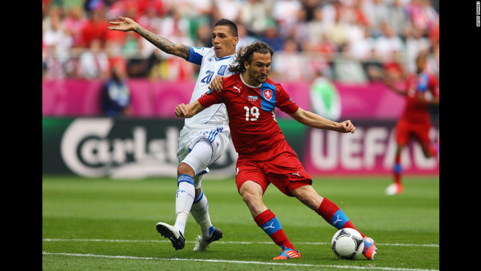 Jiracek scores the Czech Republic's opening goal against Greece and Jose Holebas on Tuesday.