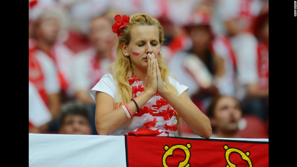 A Poland fan looks thoughtful ahead of the team's match against Russia, Tuesday.
