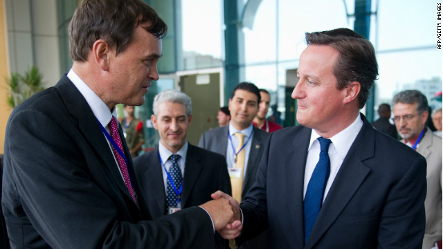British Ambassador Dominic Asquith, left, with British Prime Minister David Cameron in Tripoli on September 15, 2011.