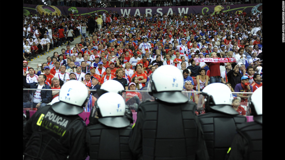 Polish riot police stand guard after the group A match between Poland and Russia.