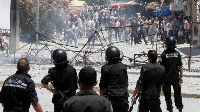 Demonstrators clash with police in Intilaka, outside Tunis, on Tuesday.