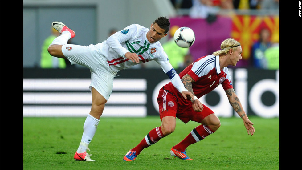 Cristiano Ronaldo of Portugal clashes with Simon Kjær of Denmark during the Group B match between Portugal and Denmark.