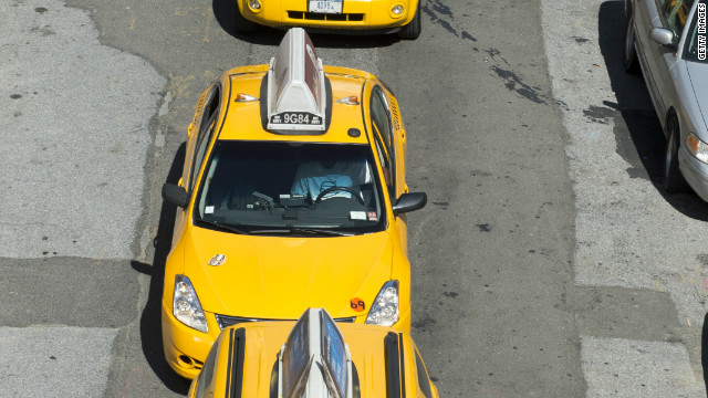 Taxis wait on a busy street June 6, 2012 in New York.