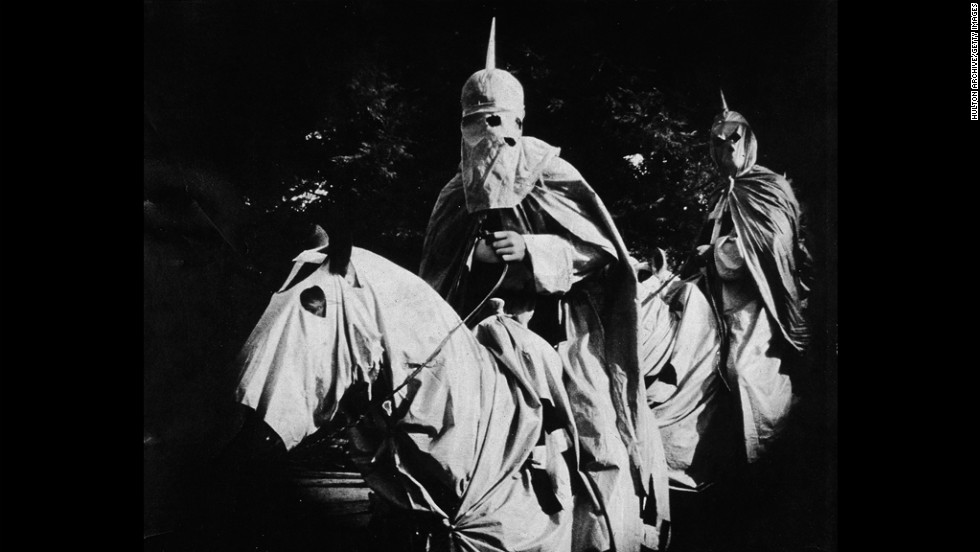 "Actors in the silent film ""The Birth of a Nation,"" released in 1915, portrayed Ku Klux Klan members dressed in full regalia and riding horses."