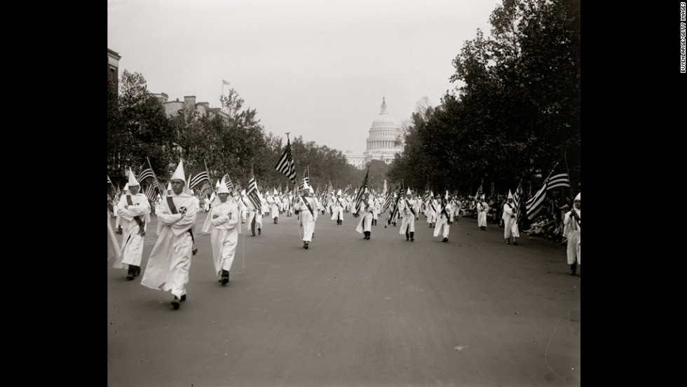 Klan members march in a parade in Washington in 1927.