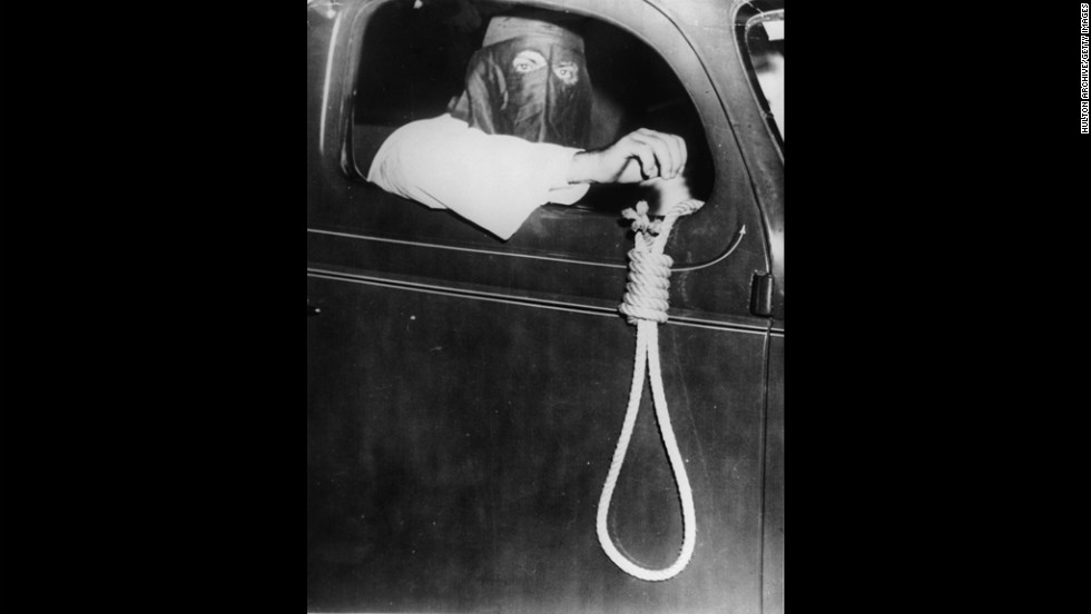 A Klan member hangs a noose out of a car window to intimidate black voters in Miami in 1939. Members drove 75 cars through the streets that day.