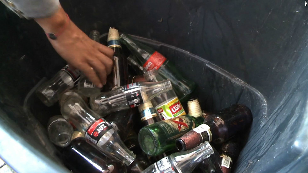 The items are separated, weighed and emptied into recycling bins.