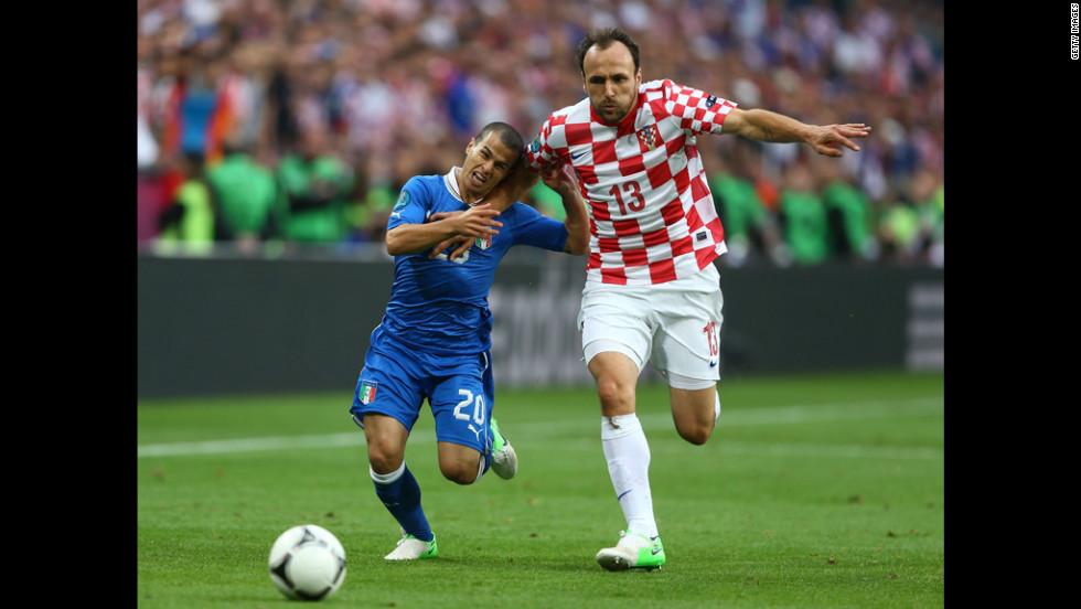 Gordon Schildenfeld of Croatia and Sebastian Giovinco of Italy battle for the ball.