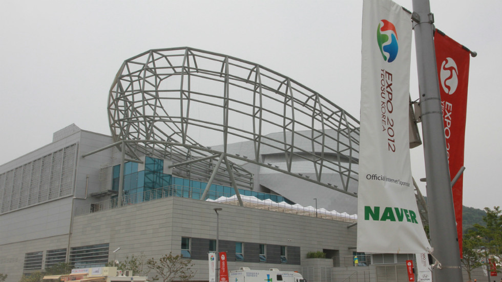 """The Korean Pavilion uses hydrogen fuel cells, geo-thermal energy and solar to be the Expo's only self-contained, carbon neutral building. It is designed to look like the Korean yin and yang """"Taegeuk"""" symbol of balance. It cost around $19 million to build."""