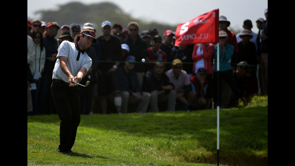 Bubba Watson plays a shot on the second hole during the first round.