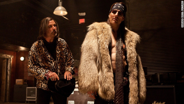 "Alec Baldwin, left, stars as Dennis Dupree and Tom Cruise stars as Stacee Jaxx in Adam Shankman's ""Rock of Ages."""