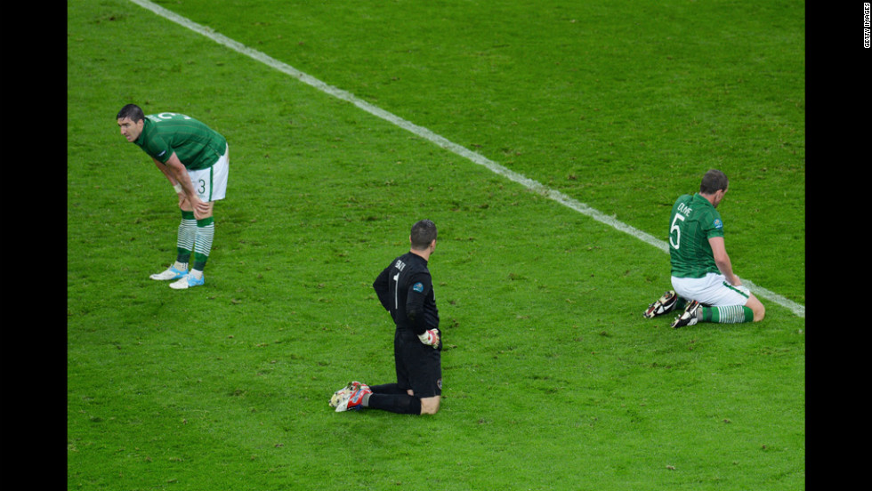 Sean St Ledger, Shay Given and  Richard Dunne of Republic of Ireland sit dejected after Fernando Torres of Spain scored Spain's third goal during the Spain-Ireland match.