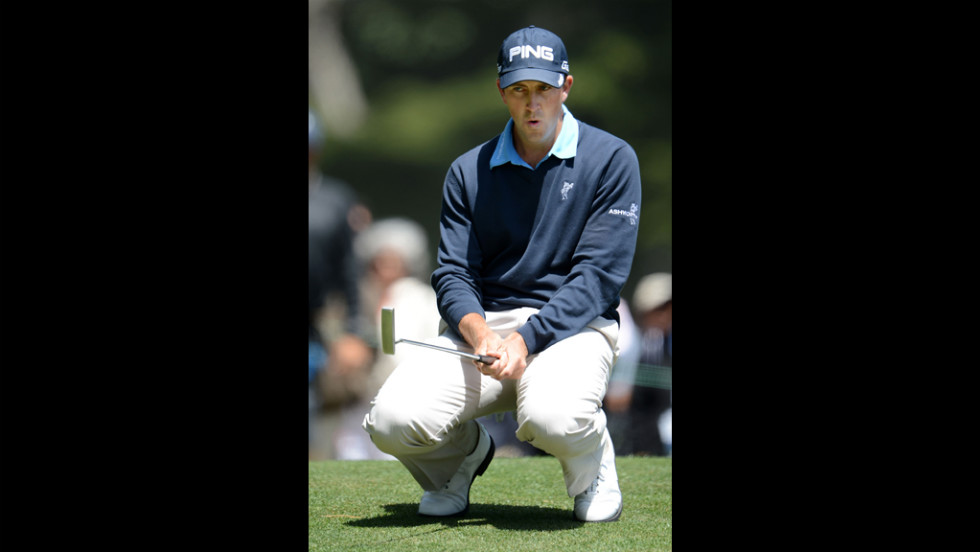 Michael Thompson of the United States reacts to a putt during the first round.