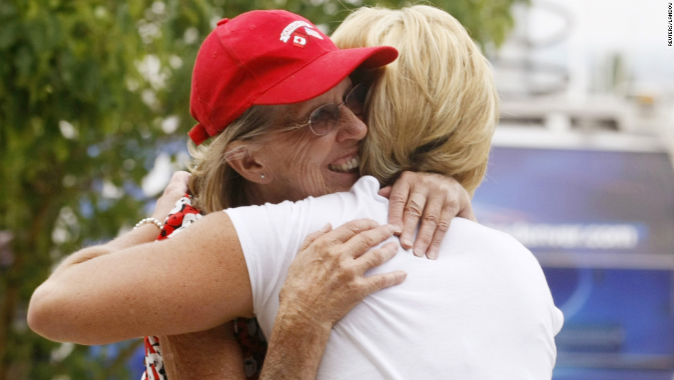 Pat Wright hugs daughter Stephanie Lauger after finding out Wednesday the High Park Fire hasn't destroyed her house. She will be able to return home three days after evacuating.