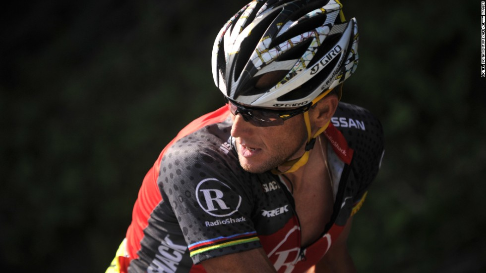 Armstrong looks back as he rides during the 2010 Tour de France.