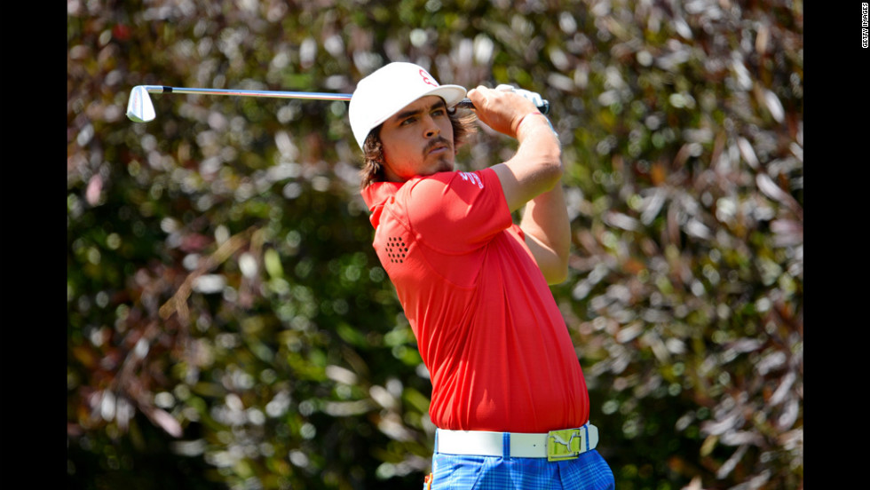 Rickie Fowler of the United States hits his tee shot on the 13th hole during the first round.