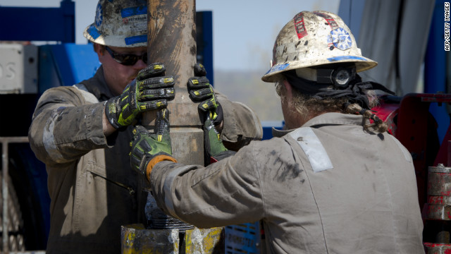 Workers change pipes at drilling rig exploring the Marcellus Shale outside the town of Waynesburg, Pennsylvania on April 13.