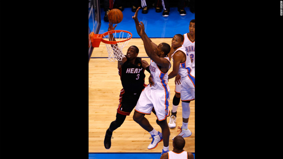 "Miami's Dwyane Wade goes up for a layup against Serge Ibaka of Oklahoma City. Check out <a href=""http://www.cnn.com/2012/06/12/worldsport/gallery/nba-finals-game-one/index.html"">photos from game one</a> of the NBA Finals."
